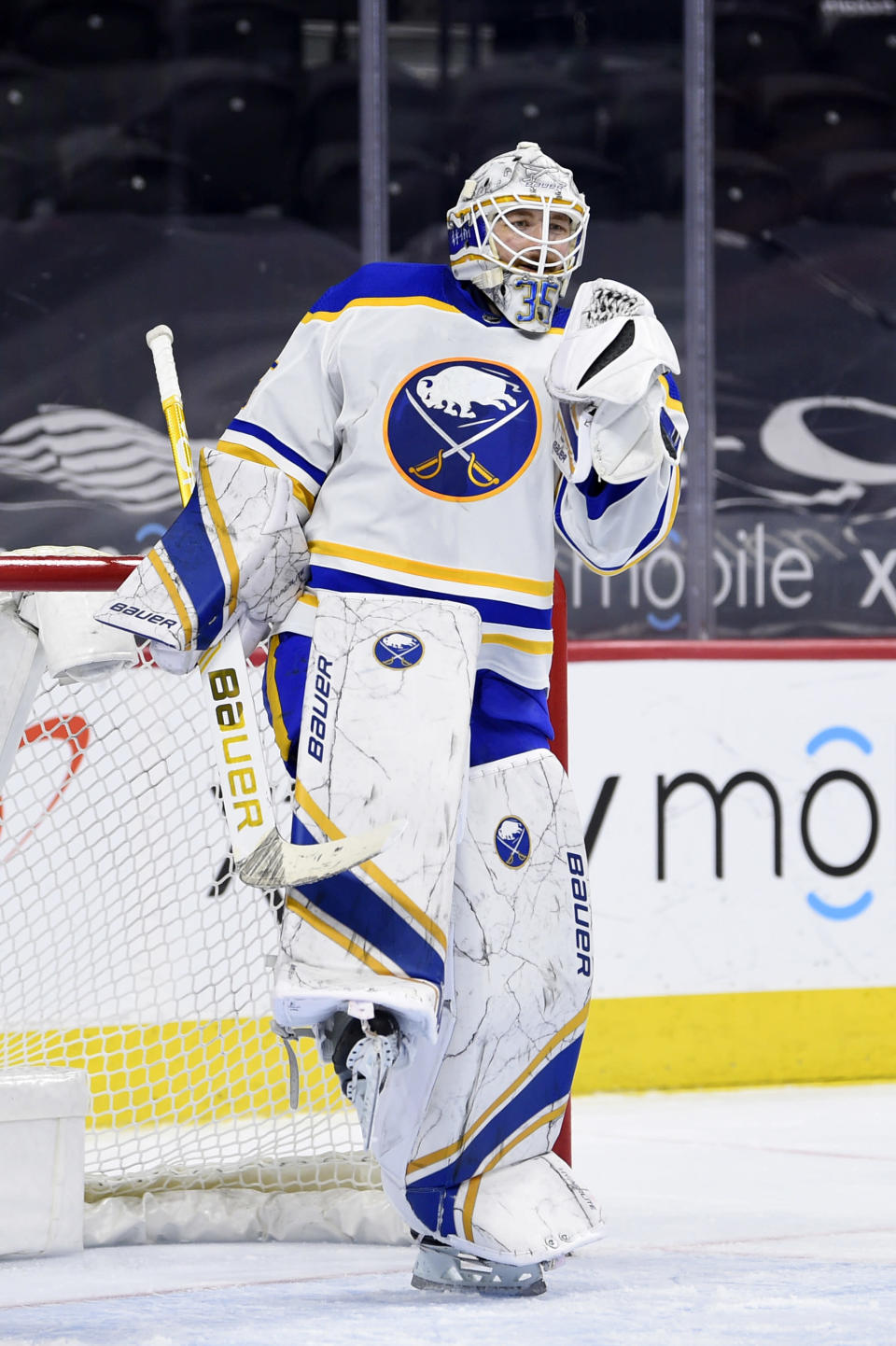 Buffalo Sabres' Linus Ullmark celebrates after the team's victory against the Philadelphia Flyers, Sunday, April 11, 2021, in Philadelphia. . (AP Photo/Derik Hamilton)