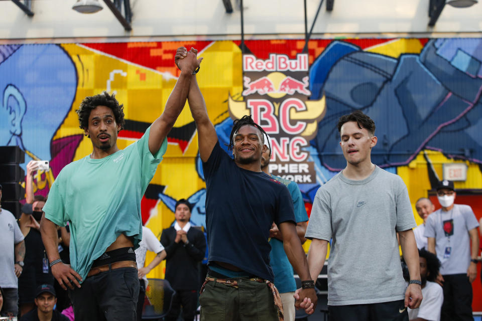 Red Bull BC One All Star Neguin, raises up the hand of B-boy Frankie, left, as he win the competition against uncle Will during Red Bull BC One event on, Saturday, July 24, 2021. in New York. Many in the breaking community are eager for the art form to expand its audience after the International Olympic Committee announced that it would become an official sport at the Paris 2024 games. But that optimism is hardly unanimous. (AP Photo/Eduardo Munoz Alvarez)