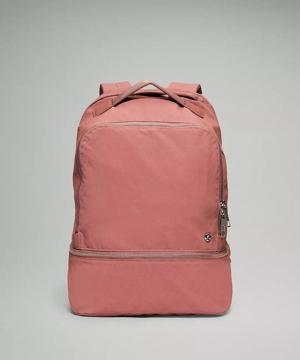 """Not only can this nylon backpack perfectly store your laptop, but it also has an expandable pocket to store away your supplies (or snacks.) $128, Lululemon. <a href=""""https://shop.lululemon.com/p/bags/City-Adventurer-Backpack/_/prod8540254?color=4171"""" rel=""""nofollow noopener"""" target=""""_blank"""" data-ylk=""""slk:Get it now!"""" class=""""link rapid-noclick-resp"""">Get it now!</a>"""