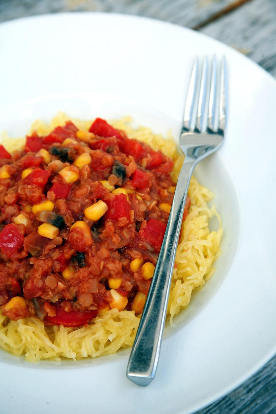 """<p>The chewy texture of the lentils is comparable to ground beef, and since the maple-cumin tomato flavor is so outstanding, your meat-loving family will love it just as much - maybe even more.</p> <p><strong>Get the recipe:</strong> <a href=""""https://www.popsugar.com/fitness/Spaghetti-Squash-Lentils-40654750"""" class=""""link rapid-noclick-resp"""" rel=""""nofollow noopener"""" target=""""_blank"""" data-ylk=""""slk:maple-cumin lentils over spaghetti squash"""">maple-cumin lentils over spaghetti squash</a></p>"""