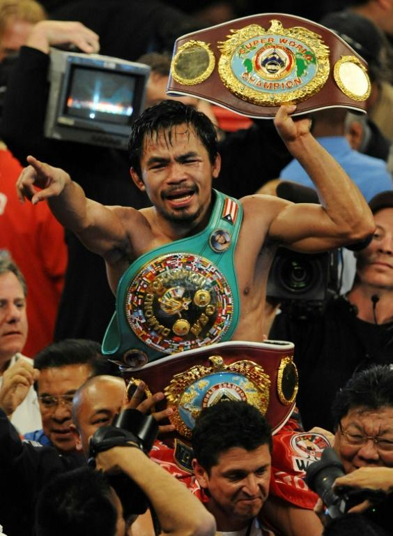Manny Pacquiao defeated Miguel Cotto in a devastating performance (AFP/MARK RALSTON)