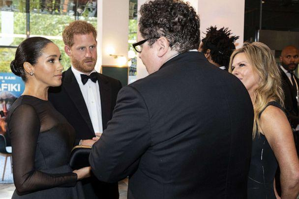 PHOTO: Britain's Prince Harry, Duke of Sussex and Meghan Duchess of Sussex chat with US film director Jon Favreau as they arrive to attend the European premiere of the film The Lion King, July 14, 2019. (REX via Shutterstock)