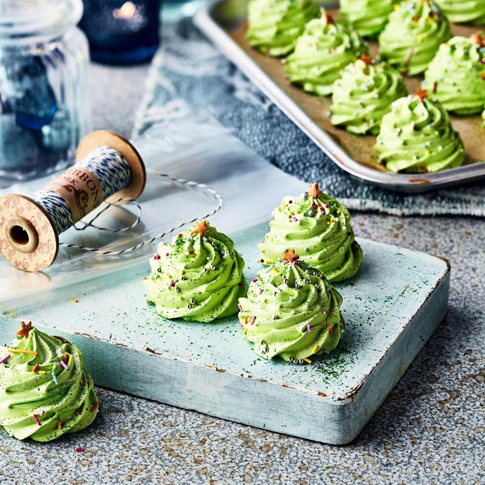 """<p>Kids will love piping and decorating these cute Christmas tree meringues – and there's no risk of tangled lights! Easy to double the recipe it you want to make more homemade Christmas gifts.</p><p><strong>Recipe: <a href=""""https://www.goodhousekeeping.com/uk/christmas/christmas-recipes/a37819938/christmas-tree-meringues/"""" rel=""""nofollow noopener"""" target=""""_blank"""" data-ylk=""""slk:Christmas Meringues"""" class=""""link rapid-noclick-resp"""">Christmas Meringues</a></strong></p>"""