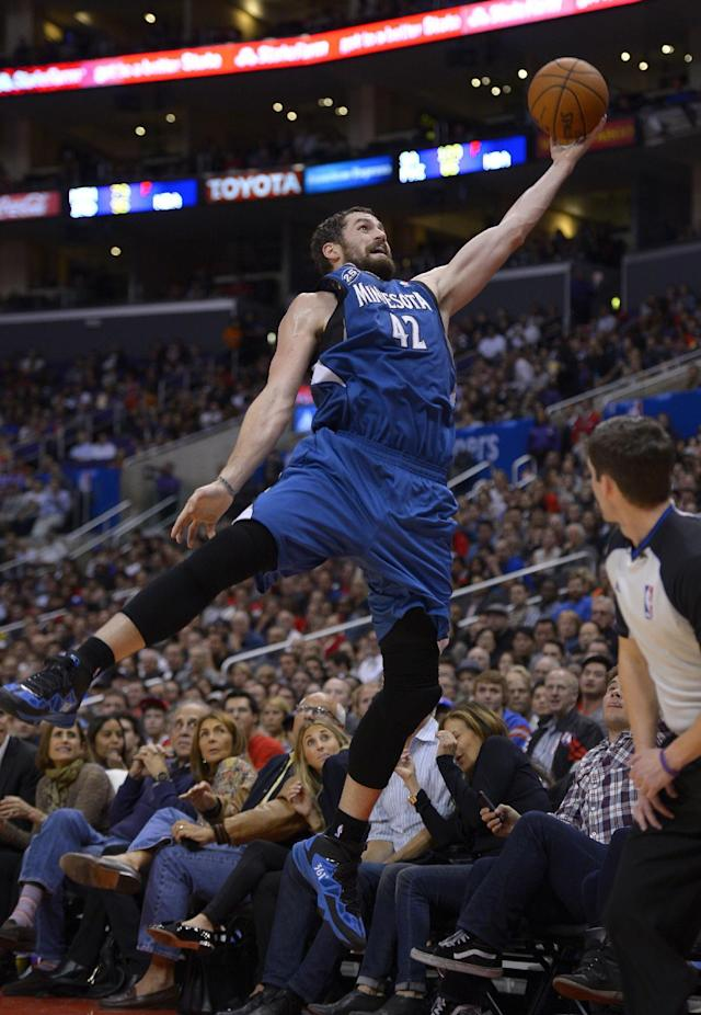 Minnesota Timberwolves forward Kevin Love leaps for a ball as it goes out of bounds during the second half of an NBA basketball game against the Los Angeles Clippers, Monday, Nov. 11, 2013, in Los Angeles. The Clippers won 109-107. (AP Photo/Mark J. Terrill)