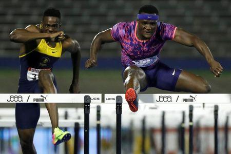 Athletics - JAAA National Senior Championships - Men's 110m hurdles final - National Stadium Kingston, Jamaica - June 24, 2017 Jamaica's Omar McLeod (R) and Ronald Levy in action. REUTERS/Lucy Nicholson