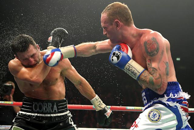 Carl Froch of Britain, left, blocks a punch from compatriot George Groves during their WBA and IBF super-middleweight title fight at the Phones 4u Arena, in Manchester, England, Saturday, Nov. 23, 2013. Froch recovered from a first-round knockdown to retain his WBA and IBF super-middleweight titles with a ninth-round technical knockout of Groves in an engrossing fight on Saturday. (AP Photo/Dave Thompson, PA Wire)