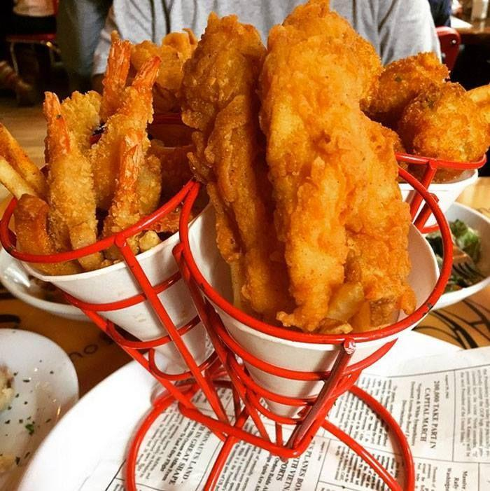 """<p>Why choose between fried delights when Bubba Gump's is offering you the chance to dig in on three? Fresh cod and shrimp and hearty hush puppies all fried in crispy, golden breading are what make <a href=""""https://people.com/food/best-chain-restaurant-dishes-america/?slide=5937218#5937218"""" rel=""""nofollow noopener"""" target=""""_blank"""" data-ylk=""""slk:Forrest's Seafood Feast"""" class=""""link rapid-noclick-resp"""">Forrest's Seafood Feast</a> at Bubba Gump's a fan favorite. It's only fitting that this dish is named for the movie we all love, that gave us this guilty-pleasure chain restaurant.</p>"""