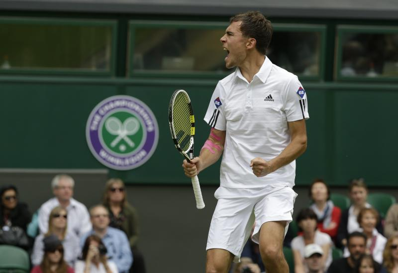 Jerzy Janowicz of Poland reacts after defeating Nicolas Almagro of Spain in their Men's singles match at the All England Lawn Tennis Championships in Wimbledon, London, Friday, June 28, 2013. (AP Photo/Anja Niedringhaus)