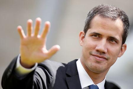 Venezuelan opposition leader Juan Guaido waves after a meeting at the European Union headquarters in Brasilia, Brazil Febbruary 28, 2019. REUTERS/Ueslei Marcelino