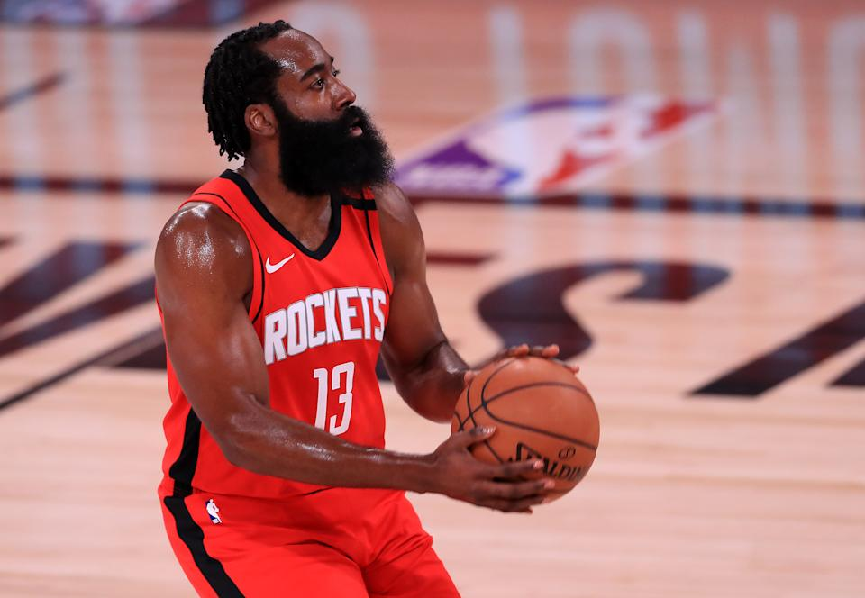 James Harden #13 of the Houston Rockets shoots the ball against the Oklahoma City Thunder during the first quarter in Game Six of the Western Conference First Round during the 2020 NBA Playoffs at AdventHealth Arena.
