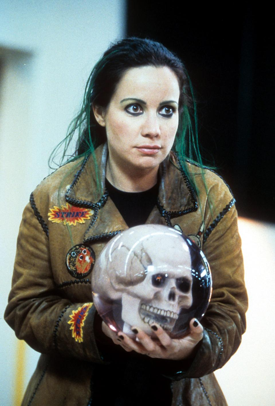 Janeane Garofalo holds an orb in a scene from the film 'Mystery Men', 1999. (Photo by Universal/Getty Images)
