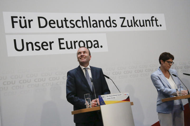 Annegret Kramp-Karrenbauer, right, Chairwoman of the Christian Democratic Union, CDU, attends a statement with European People's Party top candidate Manfred Weber, left, at the CDU headquarters in Berlin, Sunday, May 26, 2019. (AP Photo/Markus Schreiber)
