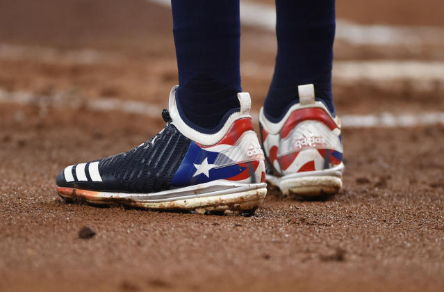 Houston Astros' Carlos Correa wears cleats representing Puerto Rico last October. (AP)