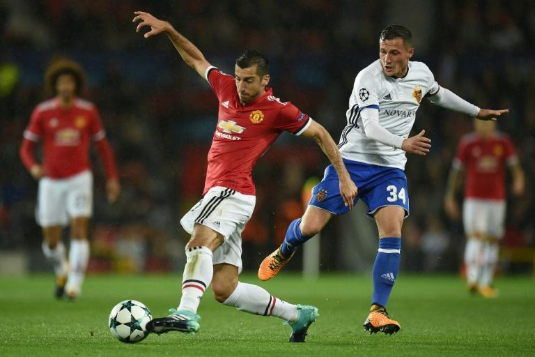 Manchester United's Henrikh Mkhitaryan (L) fights for the ball with Basel's Taulant Xhaka during their UEFA Champions League Group A match, in Manchester, on September 12, 2017