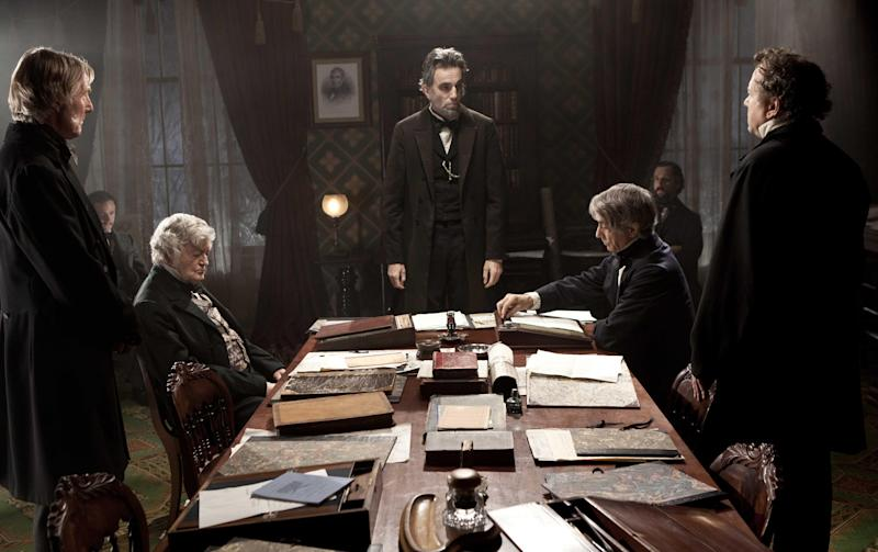 "This undated publicity photo released by Walt Disney Pictures shows, Daniel Day-Lewis, center rear, as Abraham Lincoln, in a scene from the film, ""Lincoln."" ""Lincoln"" opens in limited release Nov. 9, 2012, and nationwide Nov. 16, just after the U.S. presidential election. (AP Photo/Disney-DreamWorks II, David James)"