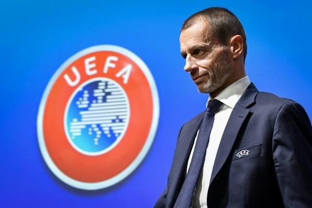 "UEFA president Aleksander Ceferin admits that a new report ""highlights a number of threats"" to European football (AFP Photo/Fabrice COFFRINI)"