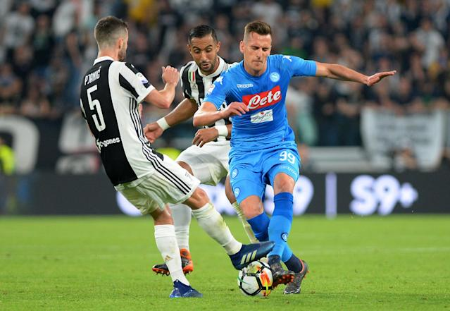 Soccer Football - Serie A - Juventus v Napoli - Allianz Stadium, Turin, Italy - April 22, 2018 Napoli's Arkadiusz Milik in action with Juventus' Medhi Benatia and Miralem Pjanic REUTERS/Massimo Pinca