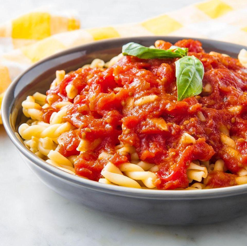 """<p>We like using (canned) whole tomatoes, and breaking them as they cook, for a chunkier marinara. If you prefer a smoother sauce, use a can of chopped tomatoes instead. </p><p>Get the <a href=""""https://www.delish.com/uk/cooking/recipes/a30311380/marinara-sauce-recipe/"""" rel=""""nofollow noopener"""" target=""""_blank"""" data-ylk=""""slk:Homemade Marinara"""" class=""""link rapid-noclick-resp"""">Homemade Marinara </a>recipe.</p>"""
