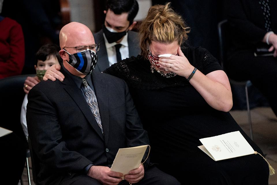 A woman cries during a congressional tribute to the late Capitol Police officer Brian Sicknick Wednesday. Source: Getty