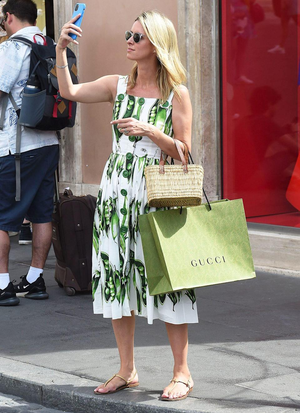 <p>Nicky Hilton enjoys a family trip to Rome while shopping with mom Kathy Hilton before joining dad Richard Hilton for lunch.</p>