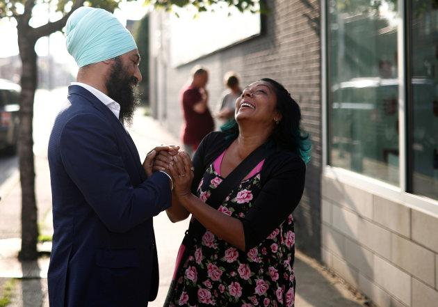 Then-NDP federal leadership candidate Jagmeet Singh shakes hands with a woman at a meet-and-greet event in Hamilton, July 17, 2017. (REUTERS/Mark Blinch)