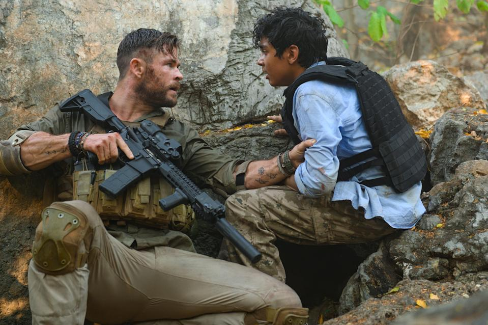 "Tyler Rake (Chris Hemsworth) is hired to rescue a crime lord's kidnapped son (Rudhraksh Jaiswal) in ""Extraction."""
