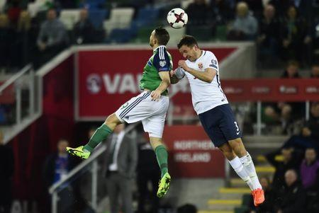 Football Soccer - Northern Ireland v Norway - 2018 World Cup Qualifying European Zone - Group C - Windsor Park, Belfast, Northern Ireland - 26/3/17 Northern Ireland's Conor Washington in action with Norway's Even Hovland Reuters / Clodagh Kilcoyne Livepic