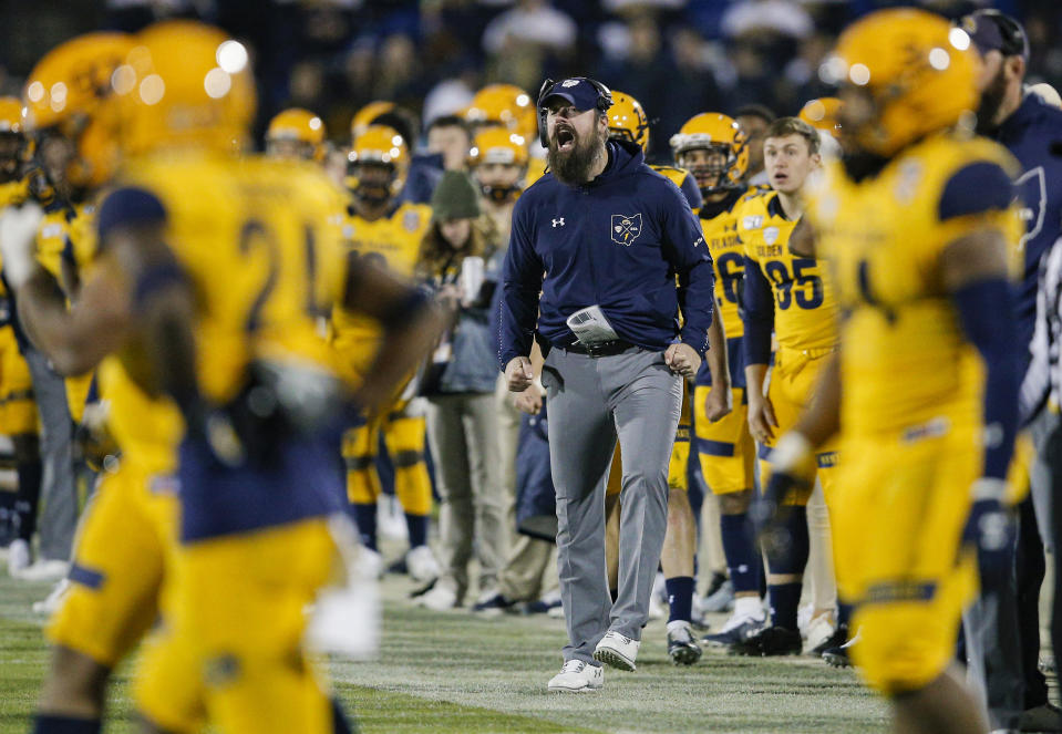 Kent State coach Sean Lewis shouts from the sideline during the second half of the team's Frisco Bowl NCAA college football game against Utah State on Friday, Dec. 20, 2019, in Frisco, Texas. Kent State won 51-41. (AP Photo/Brandon Wade)