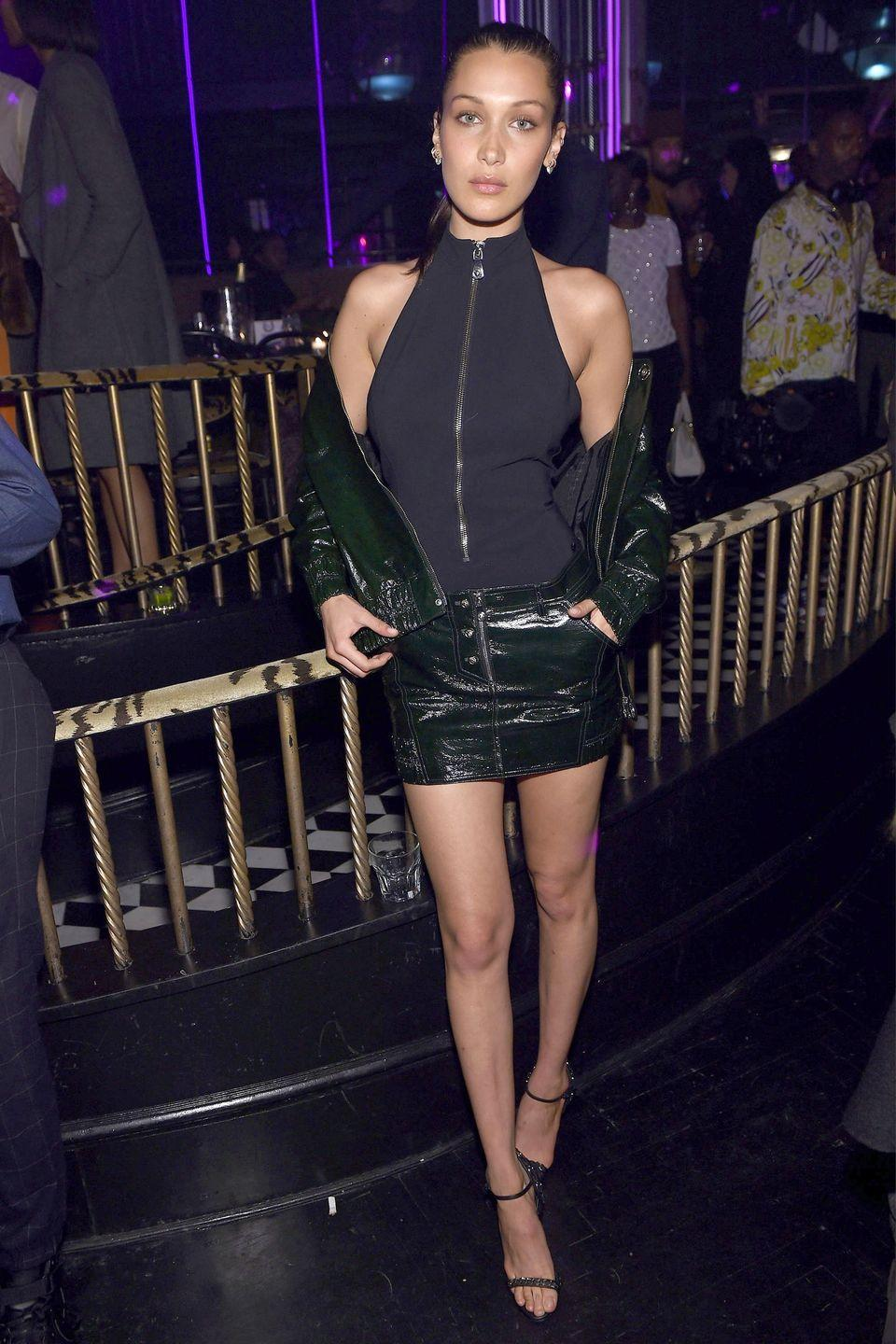 <p>In leather jacket and skirt and turtleneck singlet at Marc Jacobs & Benedikt Taschen celebrate <em>NAOMI</em> at The Diamond Horseshoe in New York City. </p>