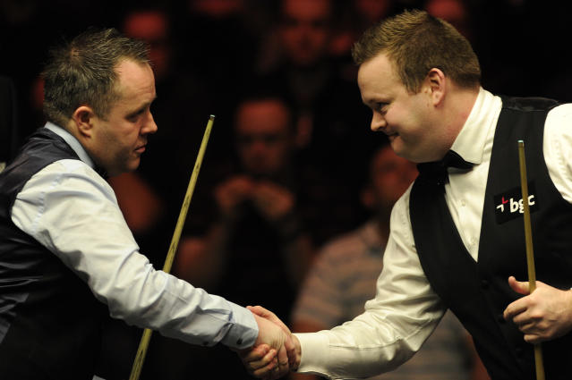 John Higgins of Scotland (L) and Shaun Murphy of England shake hands during the semi-final match in the BGC Masters snooker tournament at Alexandra Palace in north London on January 21, 2012. AFP PHOTO / CARL COURT (Photo credit should read CARL COURT/AFP/Getty Images)