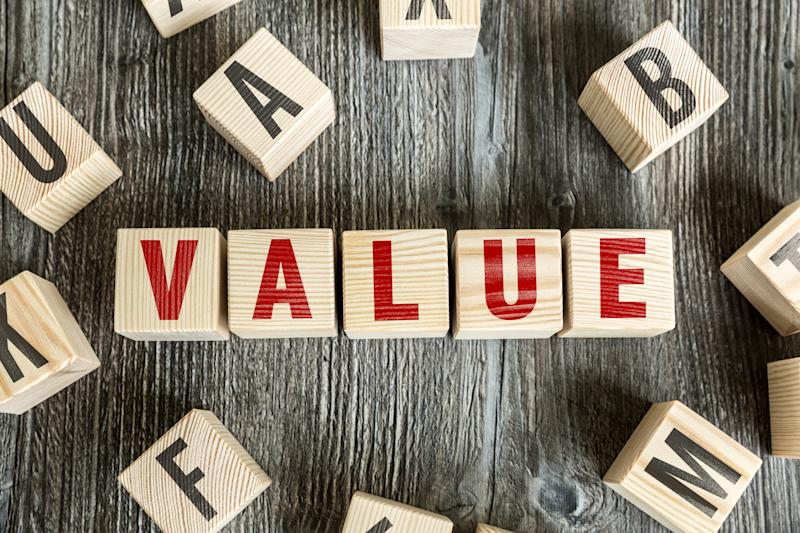The word value spelled out with red letters on wooden blocks.