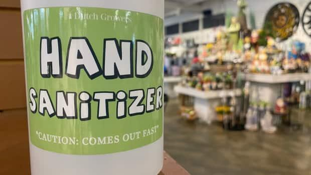 A bottle of hand sanitizer at Dutch Growers in Saskatoon, Sask., on June 23.  (Don Somers/CBC News - image credit)