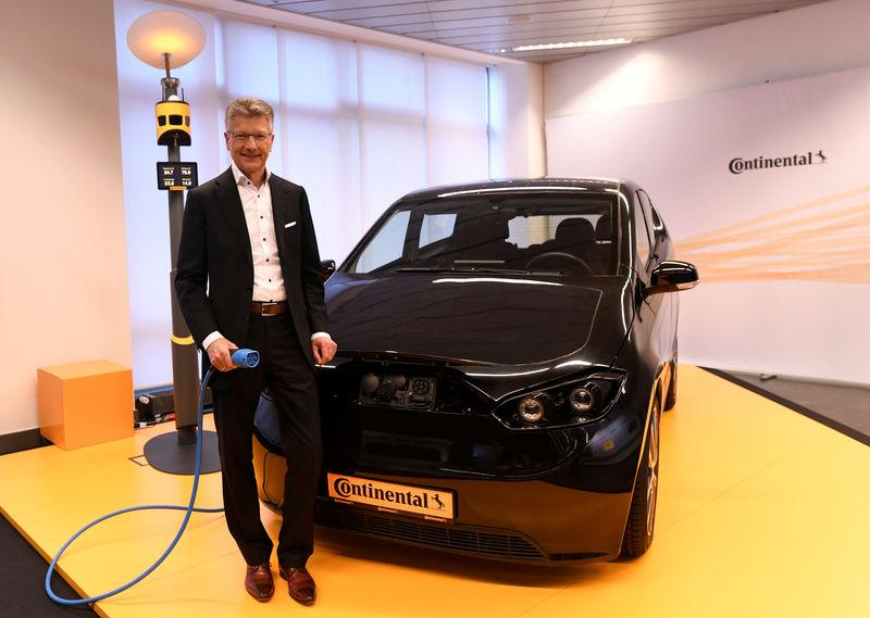 FILE PHOTO: Elmar Degenhart, CEO of German tyre company Continental poses for the media before the annual news conference in Hanover