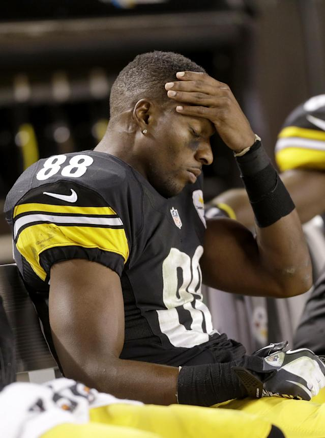 Pittsburgh Steelers wide receiver Emmanuel Sanders (88) holds his head as his team is losing to the Chicago Bears in the fourth quarter of an NFL football game in Pittsburgh, Sunday, Sept. 22, 2013. The Steelers lost 40-23. (AP Photo/Gene J. Puskar)