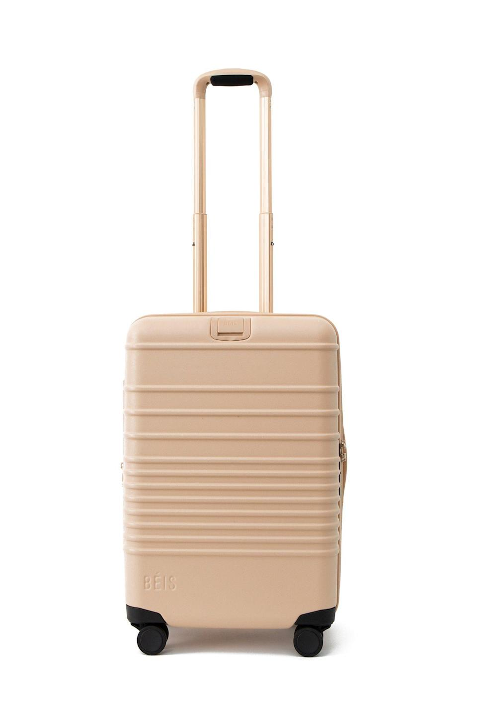 """<p>beistravel.com</p><p><strong>$198.00</strong></p><p><a href=""""https://beistravel.com/products/the-carry-on-roller-in-beige"""" rel=""""nofollow noopener"""" target=""""_blank"""" data-ylk=""""slk:BUY IT HERE"""" class=""""link rapid-noclick-resp"""">BUY IT HERE</a></p><p>When they <em>do </em>get to come visit you—or when you finally take that trip you've been planning—don't let the lugging derail the adventure. Beis's rollers are simple, chic, and expertly roomy. </p>"""