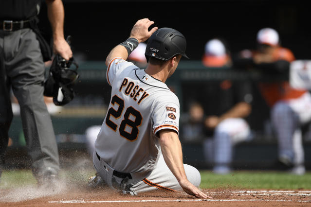 San Francisco Giants' Buster Posey slides home to score during the first inning of a baseball game against the Baltimore Orioles, Saturday, June 1, 2019, in Baltimore. (AP Photo/Nick Wass)