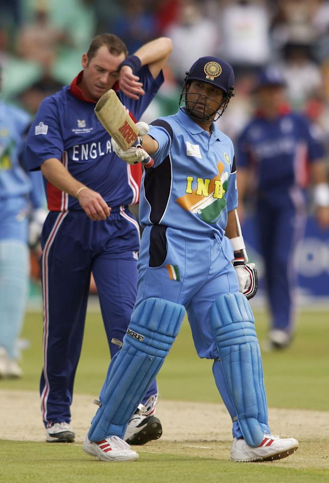 DURBAN - FEBRUARY 26:   Sachin Tendulkar of India celebrates a half century during the ICC Cricket World Cup 2003, Pool A match between England and India at Kingsmead, Durban, South Africa on February 26, 2003. (Photo by Tom Shaw/Getty Images)