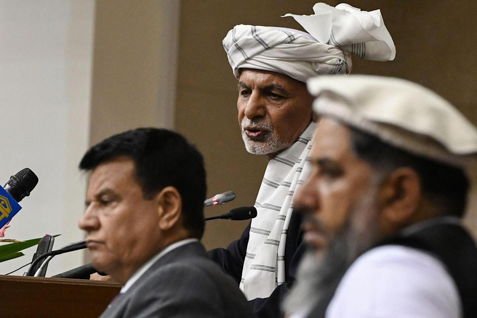 President Ashraf Ghani, centre, speaks during a meeting at the Afghan Parliament house in Kabul  (AFP via Getty Images)