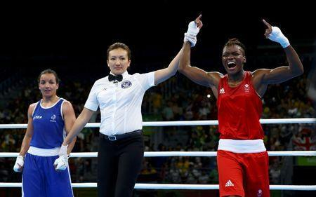 2016 Rio Olympics - Boxing - Final - Women's Fly (51kg) Final Bout 267 - Riocentro - Pavilion 6 - Rio de Janeiro, Brazil - 20/08/2016. Nicola Adams (GBR) of Britain celebrates after winning her bout against Sarah Ourahmoune (FRA) of France. REUTERS/Peter Cziborra