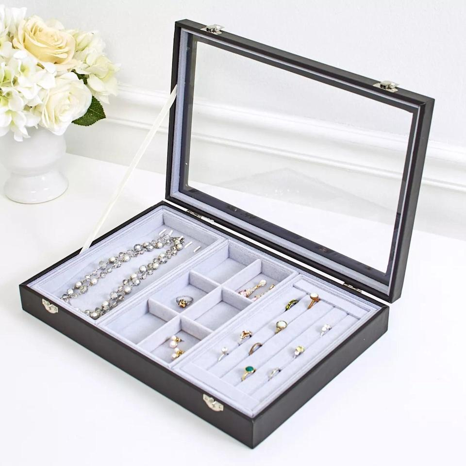 <p>Keep your most worn pieces in the <span>Lakeside Countertop Jewelry Organizer Tray with Glass Lid</span> ($21) so you can see what options you have for the day.</p>