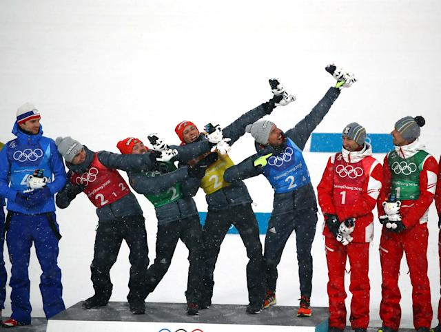 Nordic Combined Events - Pyeongchang 2018 Winter Olympics - Men's Team 4 x 5 km Final - Alpensia Cross-Country Skiing Centre - Pyeongchang, South Korea - February 22, 2018 - Gold medalists Vinzenz Geiger, Fabian Riessle, Eric Frenzel and Johannes Rydzek of Germany celebrate during the victory ceremony. REUTERS/Carlos Barria