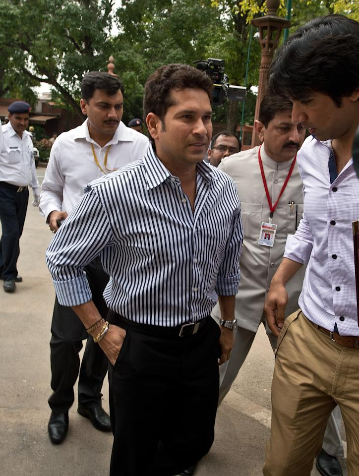 Indian cricketer and Member of Parliament Sachin Tendulkar arrives at Parliament in New Delhi on August 5, 2013. India's parliament is due to start the monsoon session with the government under intense pressure to pass key bills ahead of upcoming elections due by next year. AFP PHOTO/ Prakash SINGH        (Photo credit should read PRAKASH SINGH/AFP/Getty Images)