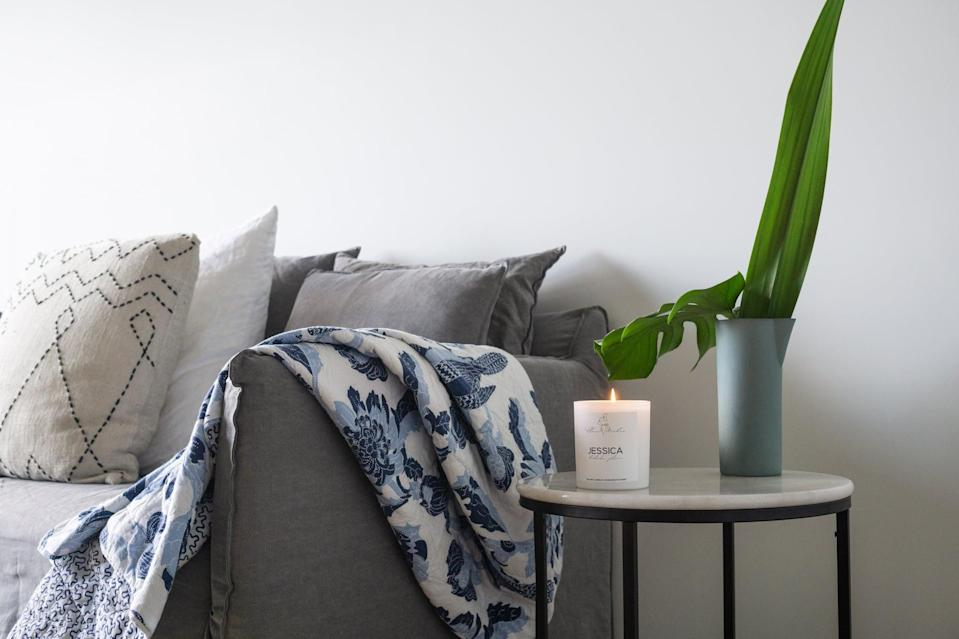 <p>Nothing makes a space feel cozy like throw pillows and blankets. There's no need to go overboard here, especially if you're working with a smaller couch. But, a few pillows and a blanket can go a long way in making your space - and your guests - feel cozy, comfortable, and totally at home. Plus, they're a functional way to add patterns or color. </p>