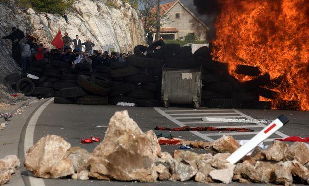 A barricade is set on fire during a protest against the enthronement of the Serbian Orthodox bishop in Cetinje, Montenegro, 05 September 2021. The enthronement of the new bishop of the Serbian Orthodox Church in Montenegro is causing a divide in Montenegro, sparking tensions between the members of the Serbian orthodox church and protestors who are opposing the ceremony taking place in the former Montenegrin royal capital.  EPA/BORIS PEJOVIC (Photo: BORIS PEJOVIC EPA)