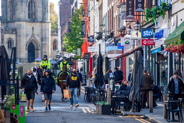Mounted police patrol along Bold Street, as the region heads into a level 3 local lockdown, in Liverpool, UK.