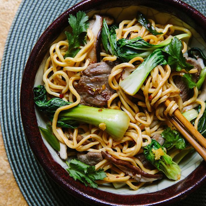 <p>Serve this spicy pork-and-vegetable lo mein for Chinese New Year or for dinner anytime. While some cooks like to cut the noodles into 6- to 8-inch lengths to make them easier to combine with other ingredients, for the New Year the noodles can never be cut because that symbolizes bad luck. The longer the noodles, the longer your life! Be sure to thinly slice the pork and mushrooms so they cook through. And thoroughly dry the bok choy to avoid creating a braise instead of a stir-fry.</p>