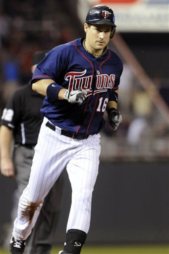 Minnesota Twins' Josh Willingham rounds the bases on a solo home run off Seattle Mariner pitcher Jason Vargas in the fifth inning of a baseball game, Wednesday, Aug. 29, 2012, in Minneapolis. (AP Photo/Jim Mone)