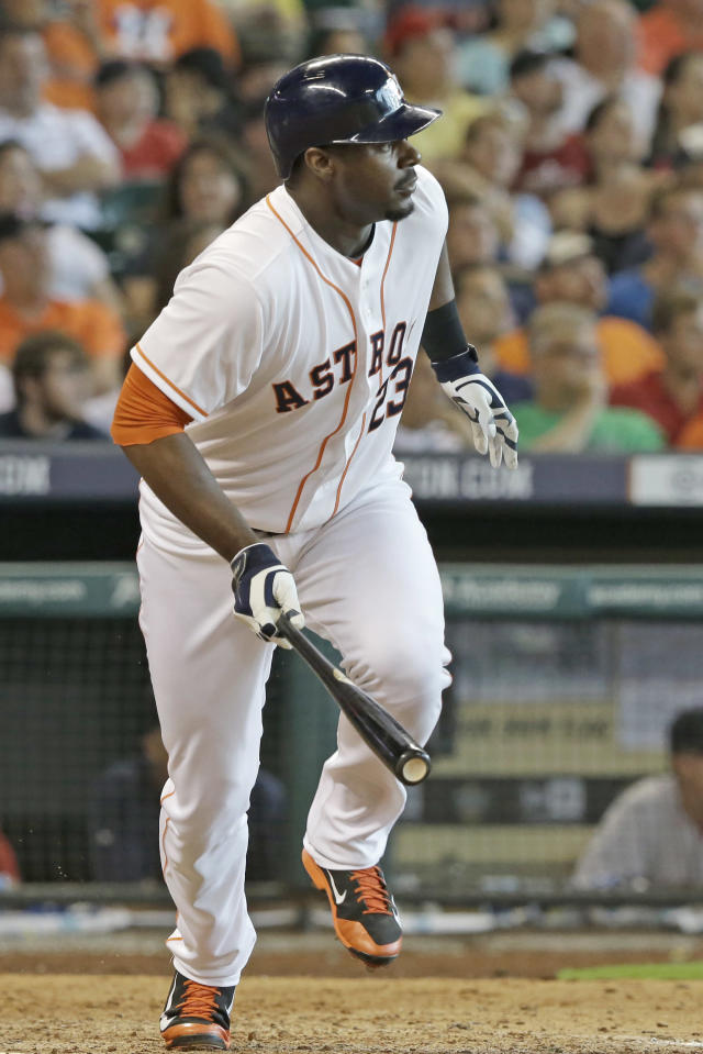Houston Astros' Chris Carter heads up the first base line with an RBI single for the go-ahead run in the eighth inning of a baseball game against the Boston Red Sox Saturday, July 12, 2014, in Houston. The Astros won 3-2. (AP Photo/Pat Sullivan)