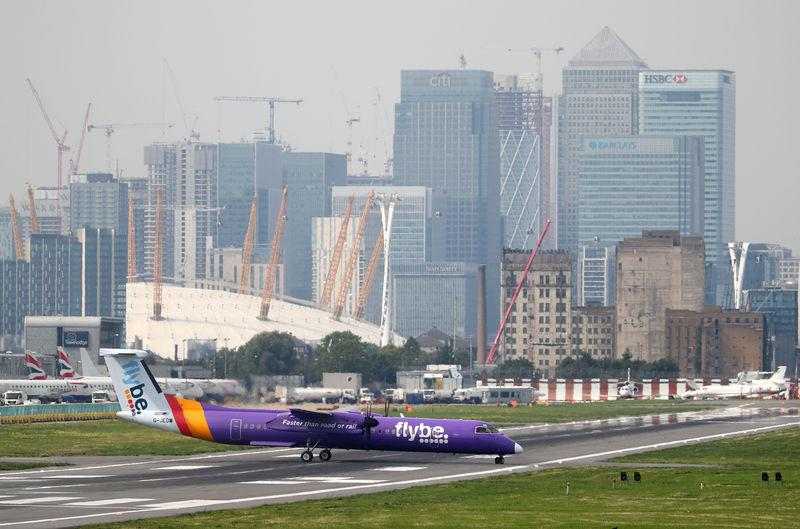 FILE PHOTO: A Flybe Bombardier Dash 8 Q400 airplane taxis at City Airport in London, Britain, September 3, 2018. REUTERS/Hannah McKay/File Photo