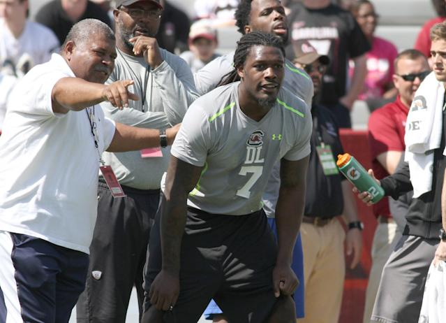 South Carolina defensive end Jadeveon Clowney competes in a drillfor NFL representatives at South Carolina football pro day in Columbia, S.C., Wednesday, April 2, 2014. (AP Photo/Mary Ann Chastain)